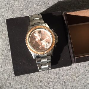 Silver/gold Michael Kors watch with pink face.